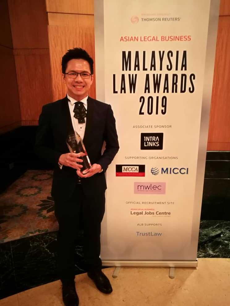 Edwin Lee of GLT accepting the Law Awards 2019